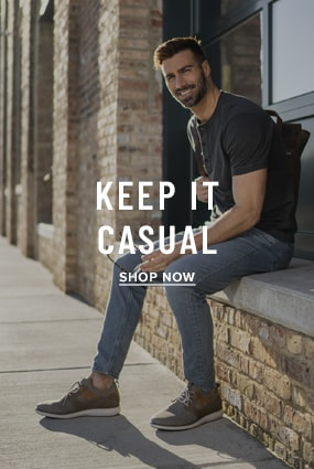 Men's Bags category. The featured image is of a model sitting down wearing the Venture Knit Plain Toe Lace Up Sneaker. Click to shop the Florsheim Casual category.
