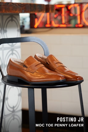 Boy's Dress Shoes category. The featured product is the Postino Jr. Moc Toe Penny Loafer in Cognac.