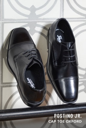 Boy's Uniform Shoes category. The featured product is the Postino Jr. Cap Toe Oxford in Black.