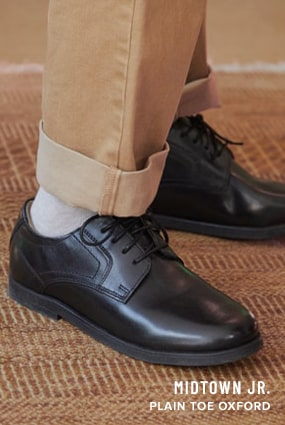 Boy's Dress Shoes category. The featured product is the Midtown Jr. Plain Toe Oxford in Black.