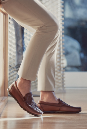 Image of a man wearing the Draft Moc Toe Woven Driver in Cognac.