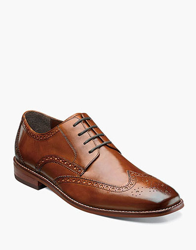 The featured product is the Castellano Wingtip Oxford in Saddle Tan.