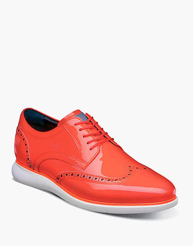 Florsheim Fuel Reflect Neon Wingtip Oxford in Coral for $195.