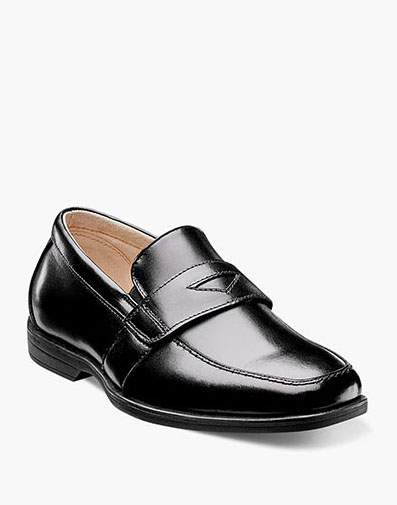Reveal Jr. Moc Toe Penny Loafer in Black for 59.95 dollars.