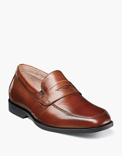 Reveal Jr. Moc Toe Penny Loafer in Cognac for 59.95 dollars.